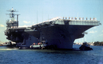 Aircraft Carrier Lead by Tugboats into Port Everglades by Courtesy of the Naval Air Station Fort Lauderdale Museum