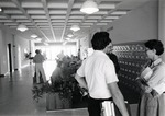 Students gather in the lobby of the Parker building, circa 1975