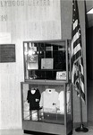 A display case filled with memorabilia stands in the lobby of the Mailman/Hollywood building, circa 1980