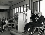 Unknown naval officer speaking at the dedication ceremony for the Edwin M. and Ester L. Rosenthal Student Center. Seated on the podium left to right: James Farquhar and Edwin M. Rosenthal