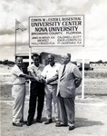 In photograph right to left: W.W. Caldwell (owner of Caldwell Scott Engineering and Construction Company of Fort Lauderdale, Florida) and Sam Freed (Head of Physical Plant) gather at the construction site for the Edwin and Ester L. Rosenthal University Center. The identities of the two other men in the photograph are unknown