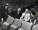 In photograph left to right: Abraham Fischler (standing) second President of Nova University 1970-1992, chats with Abraham Mailman (businessman, banker, philanthropist and the founder of the town of Miramar in Florida), Dr. Myron Segal (surgeon and son-in-law of Abraham Mailman) and Marilyn (Mickey) Segal (daughter of Abraham Mailman)