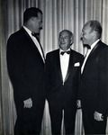 In photograph left to right: Warren Winstead, first President (1965-1969) of what was incorporated as Nova University of Advanced Technology in 1964, chats with Abraham Mailman (businessman, banker, philanthropist and the founder of the town of Miramar in Florida) and Abraham Fischler, who at that time was the Dean of the School of Education and who would later serve as the second President of Nova University 1970-1992