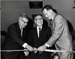 Ribbon cutting at the Edwin M. and Ester L. Rosenthal Student Center dedication ceremony, May 1 1967. In photo left to right: James Farquhar, Edwin L. Rosenthal, and Warren Winstead first President (1965-1969), of what was incorporated as Nova University of Advanced Technology in 1964