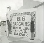 Hanging the sign for the Bazaar