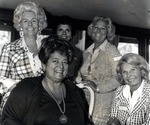 A Royal Dames meeting aboard the yacht Southern Trail in the fall of 1974. Seated in the photograph (on the left) is Theresa Castro, President of the Royal Dames. The other two identifiable women in the photograph are Dolly Granatelli, wife of J &P CEO Andy Granatelli standing fourth from the left and Millicent Steele, wife of Robert Steele sitting next to Theresa Castro