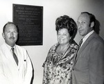 Dr Joel Warren (left), Director of the Leo Goodwin Institute for Cancer Research 1969-1980, Theresa Castro (President of the Royal Dames) and Abraham Fischler (second President of Nova University 1970-1992), standing in front of a plaque honoring Theresa Castro for all her philanthropic work on behalf of the Leo Goodwin Institute for Cancer Research Center. The plaque was hung in the Parker building on Nova's main campus where the Leo Goodwin Institute for Cancer Research Center was located