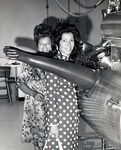 Theresa Castro, President of the Royal Dames and cofounder of Castro Convertible sofas, and her daughter Bernadette Austin (also a member of the Royal Dames) examining the laboratory equipment at the Leo Goodwin Institute for Cancer Research