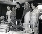 Royal Dames luncheon in honor of Leo Goodwin Sr. to celebrate his philanthropic work. Around the buffet table left to right: Fran Goodwin (wife of Leo Goodwin Jr.), Theresa Castro (President of the Royal Dames), Leo Goodwin Jr., Betty Rumstrom and Nan Farquhar