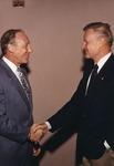 Abe Fischler shaking hands with Zbigniew Brzeinski by Nova Southeastern University