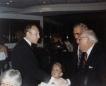 Abe Fischler shaking hands with Claude Pepper by Nova Southeastern University