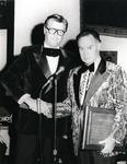 Local CBS news anchor Ralph Renick presents an award to Leo Goodwin, Jr.
