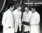 Ph.D. students hold discussions in the Germ-free laboratory by Stan O'Dell