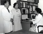 Dr. Joel Warren, Director of the Leo Goodwin Institute for Cancer Research (1969-1980), Mrs. Nan Farquhar, wife of James Farquhar, first Chairman of the Board of Directors Nova University and Devi Vembu, Ph.D. student (sitting)