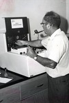 Dr. Joel Warren, Director of the Leo Goodwin Institute (1969 - 1980), measures protein in a tumor using a microdensitometer