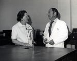Nan Farquhar and Dr. Joel Warren, Director of the Leo Goodwin Institute for Cancer Research (1969-1980), discussing the Germ-free laboratory