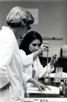 Miriam Sacksteder, Deputy Director of the Germ-free laboratory, instructs a Ph.D. student on how to perform an experiment