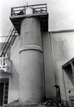 Photograph of a twenty-four foot water tower used for water testing oceanographic instruments. This tank facilitates the evaluation of instruments in an environment approximating that of the ocean
