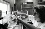 A graduate student performs an experiment in one of Nova University Oceanographic Center's laboratory, 1970