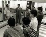 Dr. William Springer Richardson, Director of Nova University Oceanographic Center (far left), talks to television personality and Tonight Show host Johnny Carson (photographed with sunglasses on), Johnny Carson's three sons Richard, Christopher, and Cory (far right), and other Nova staff members in an oceanographic laboratory, 1969