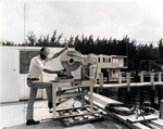 Dr. Richard Dodge, Associate Director of Nova University Oceanographic Center in Port Everglades sectioning coral skeletons, circa 1980
