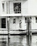 An office worker on board the houseboat that housed the library and administrative offices of the Nova University Oceanographic Center in the 1960s and early 1970s