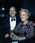 Stephen Feldman, third President (1992-1994) of what was formerly known as Nova University, and Mary McCahill, first female chair of the Board of Trustees attend a university event. During his administration there was a change in the institution name when Nova University merged with Southeastern University of the Health Sciences to form Nova Southeastern University