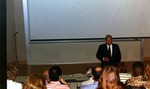 Ovid C. Lewis, fourth President of Nova Southeastern University (1994-1997), lectures to students in a classroom